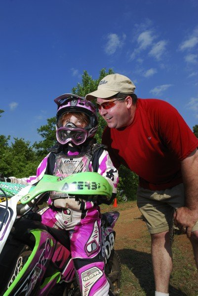 A father encourages his daughter at the Make Promises Happen race in Guthrie.