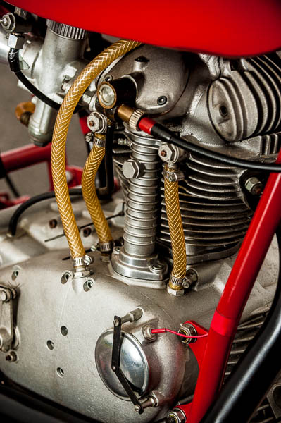 This motor was built prior to desmo valve actuation. It was a sand-cast motor built just for racing and featured external oil lines.