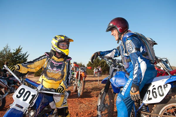 Glen Sinclair and his daughter converse in between practice laps at an OCCRA race in Wellston, OK.