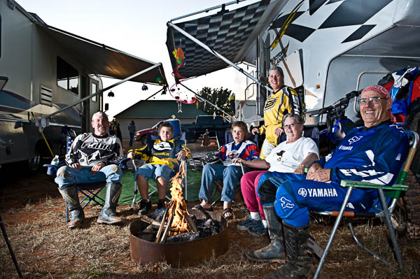 Glen Sinclair and his family sit around at their motor home in between practice at an OCCRA dirt bike race.