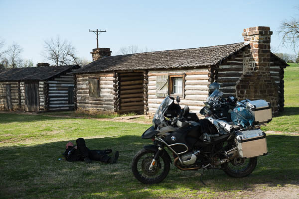 Bill Dragoo takes his usual afternoon motorcycling nap in the shade of an oak tree at Fort Gibson.