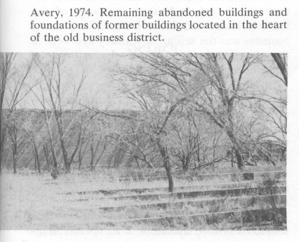 Avery, 1974. Remaining abandoned buildings and foundations of former buildings located in the heart of the old Avery business district.
