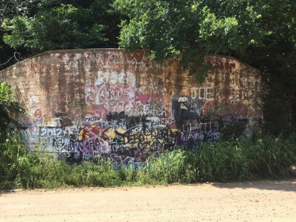 An old river bridge over the Cimarron River has been decorated by many graffiti artists over the years.