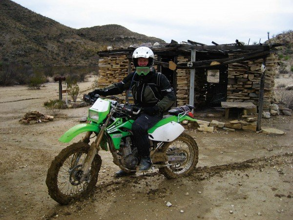 Bill Dragoo on his KLX-250 in Big Bend National Park after a rare rain. The bentonite clay turned into sticky cement as it dried.